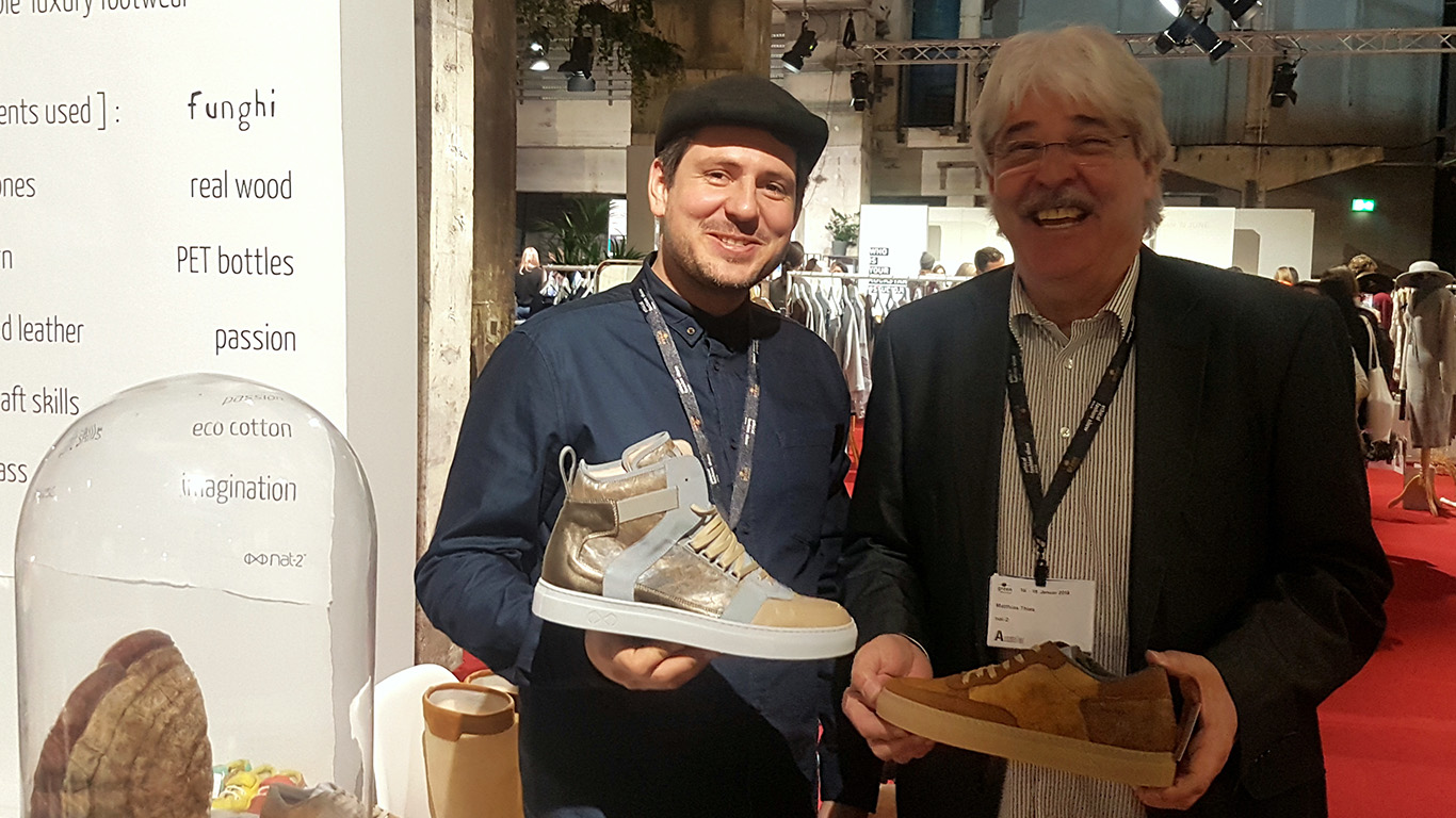 Another sustainable fashion innovation: Sebastian (l.) and Matthias Thies present their sneakers made from stone and rubber boots made from sweet corn