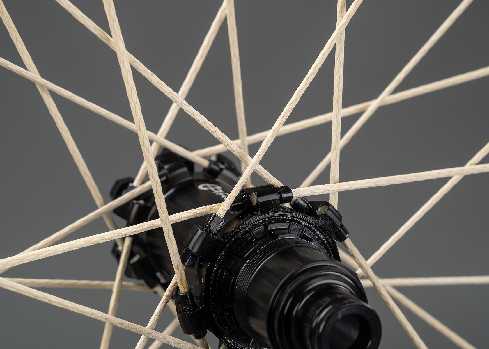 Be careful crossing the fibre spokes over one another. One wheel can take up to 32 spokes. (Source: Pi Rope)