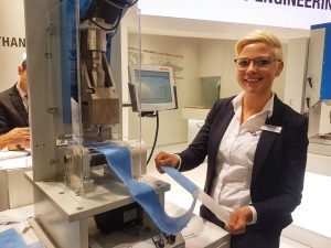 Joining nonwoven layers using ultrasonic welding: sales engineer Sarah Kniehl at one of the larger Herrmann machines